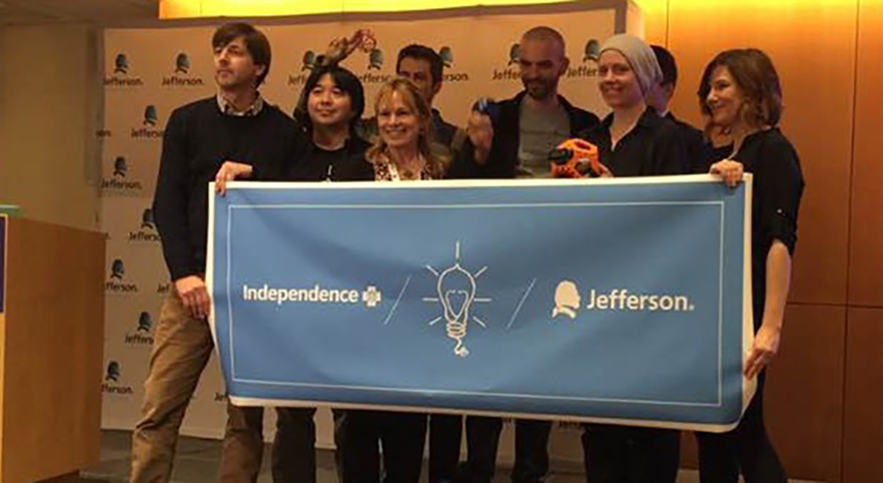 The Tigerdrone team holding and Independence Blue Cross / Jefferson banner