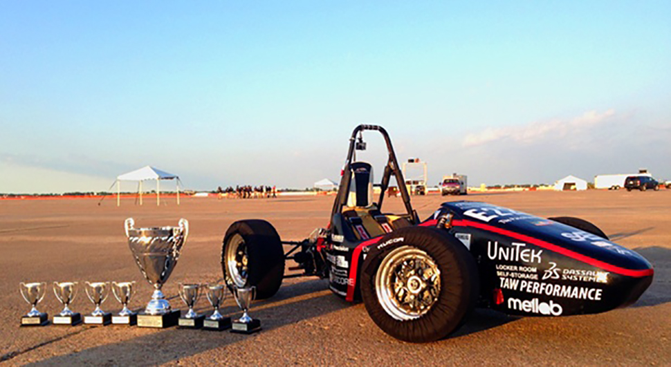 UPenn Electric Race Team race car with trophies