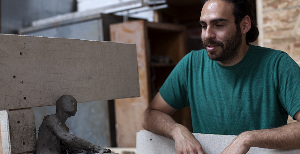 Miguel Antonio Horn working on a sculpture at NextFab
