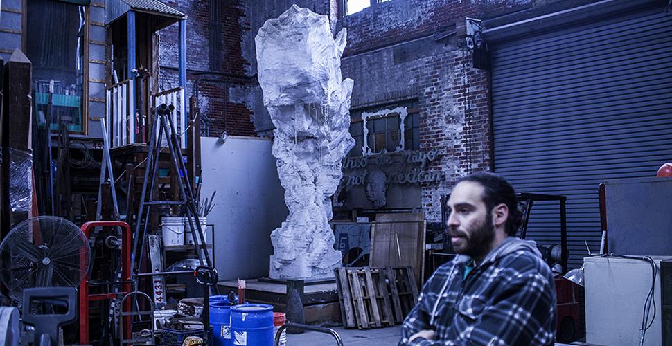 Miguel Antonio Horn with sculpture at NextFab