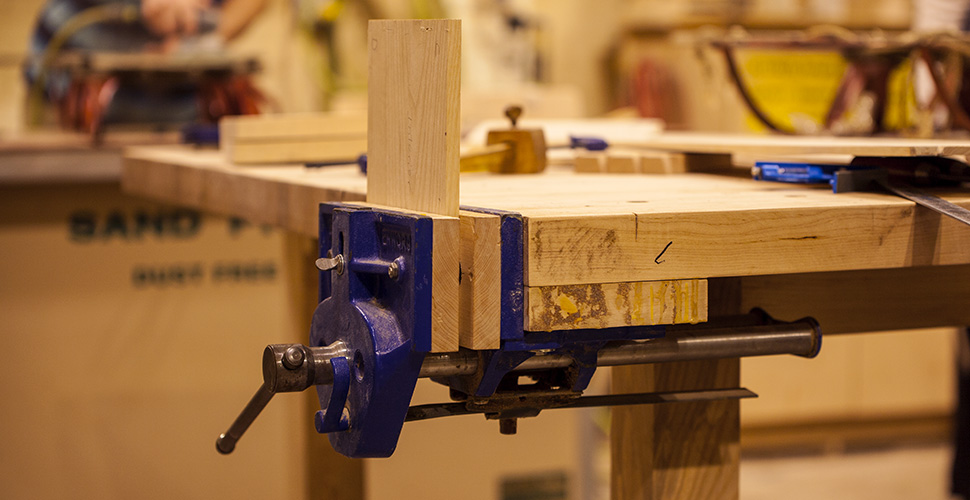 Close up of a wood shop work bench at NextFab makerspace
