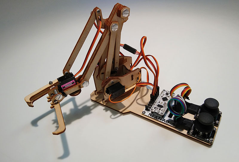 Assembled robotic arm - learn to build with laser cutting, Arduino implementation, circuit soldering