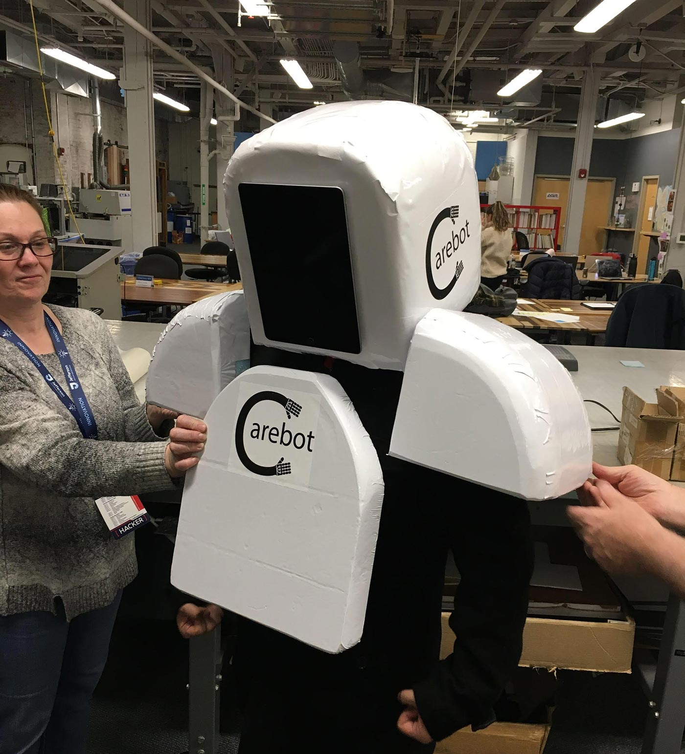 "NextFab ""Reimagining Death"" team try on their ""Carebot"" prototype."